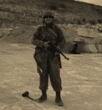 WW2 reenactor posing with rifle